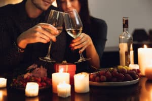 Romantic date with candles, wines, and grapes